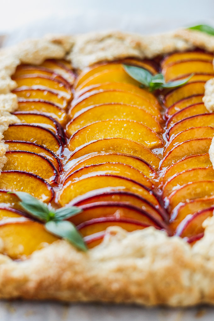 up close rows of peach slices in a sweet galette