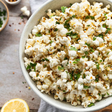 Up close bowl of lemon parsley popcorn.