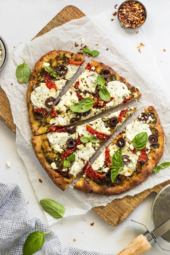 Mediterranean Flatbread Sliced on cutting board.