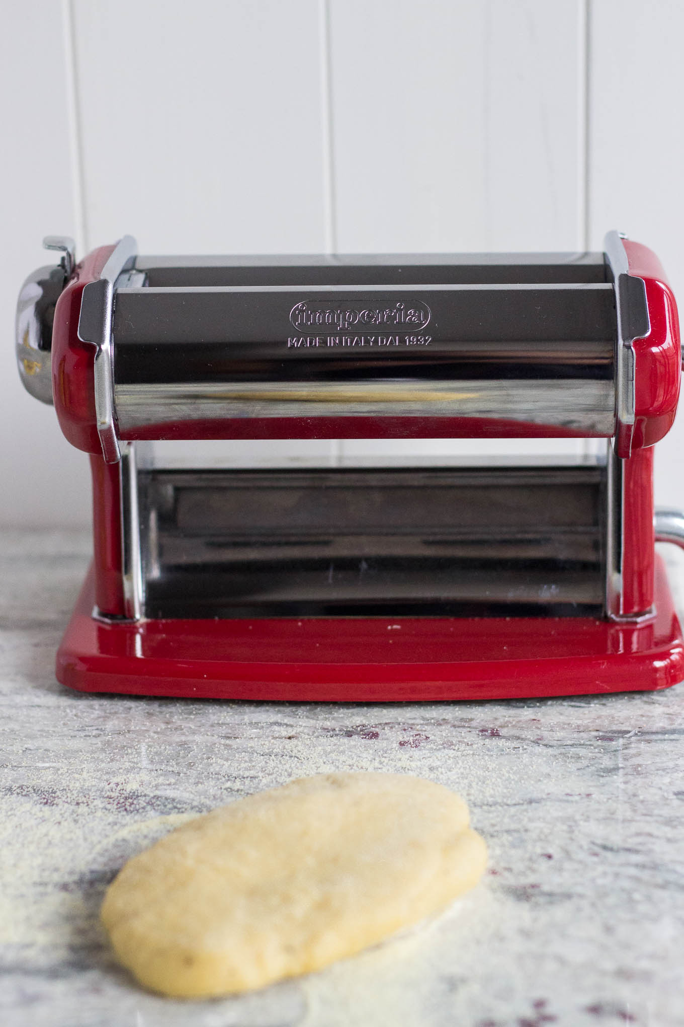 homemade pasta dough in front of pasta machine