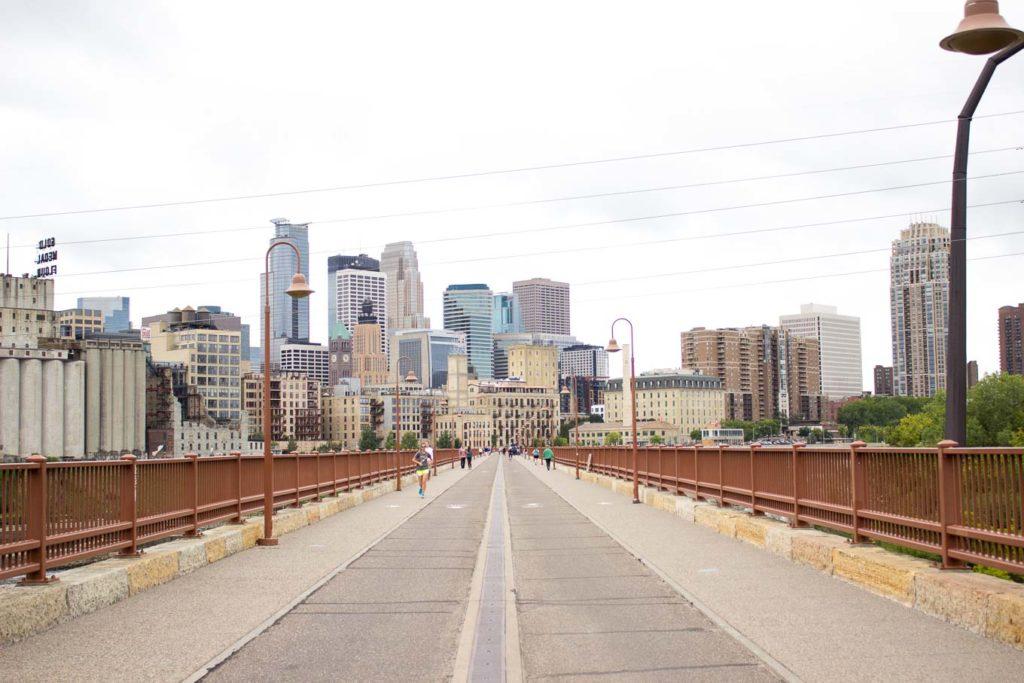 view of Minneapolis skyline from Stone Arch Bridge