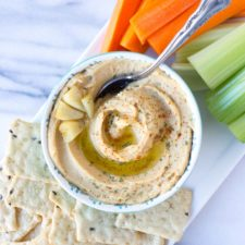 Roasted Garlic Hummus - smooth, creamy hummus with the rich, deep flavor of roasted garlic throughout. Perfect to serve as an appetizer, spread on a sandwich, or take for lunch!