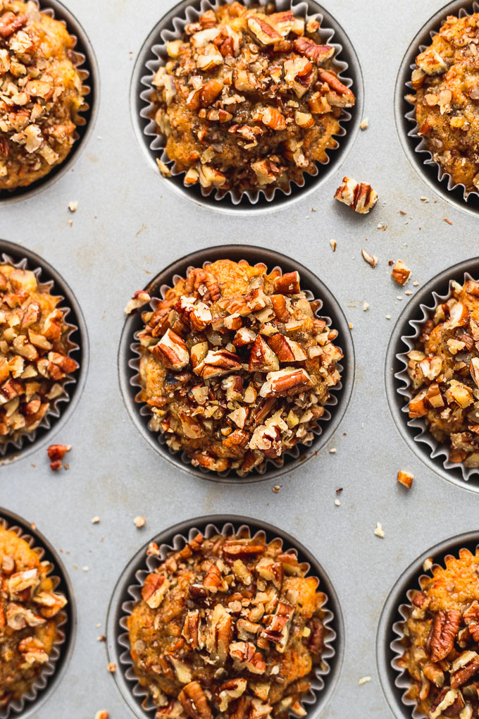 Top down of baked banana carrot muffins in muffin tin.