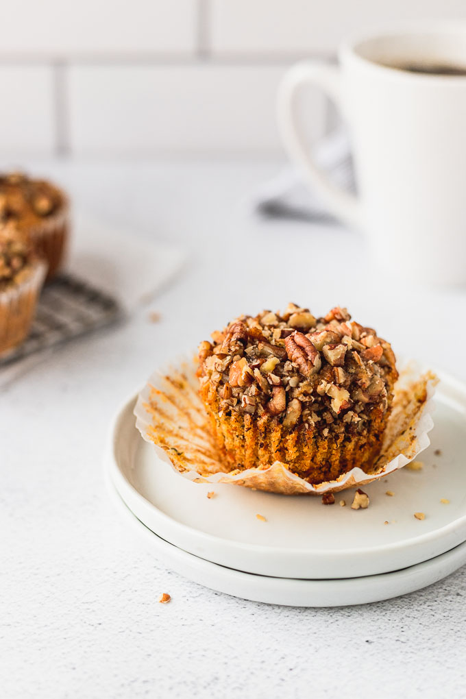 banana carrot muffin on plate with wrapper peeled