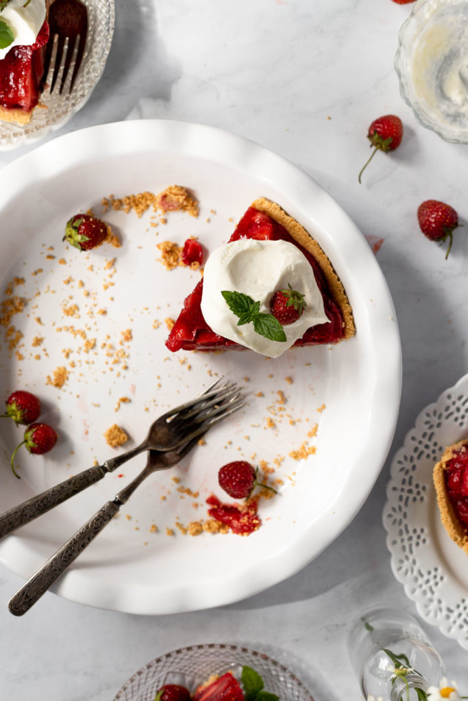 Slice of pie in pie plate with fork.