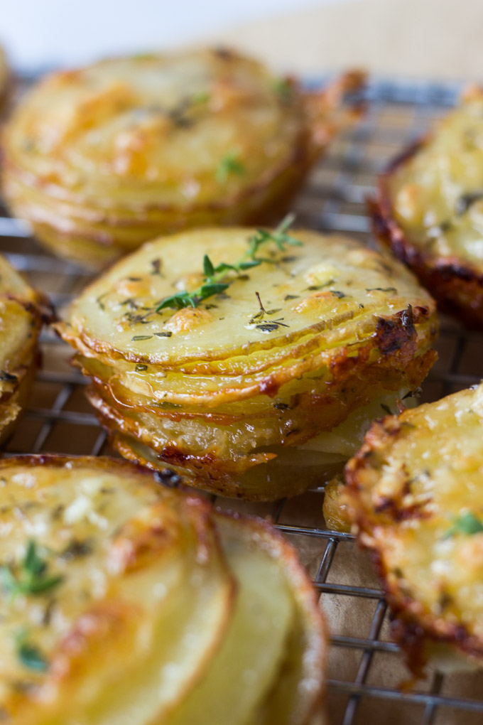 side view of gruyere and thyme stacked potatoes on cooling rack