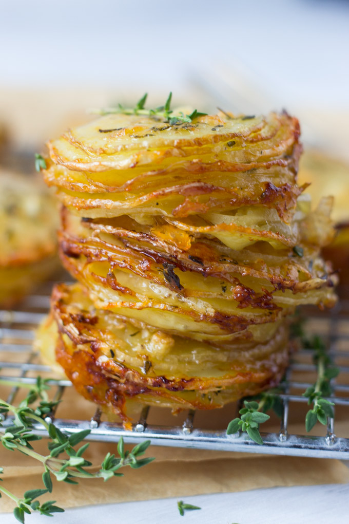 stack of potatoes with thyme on top and on the side