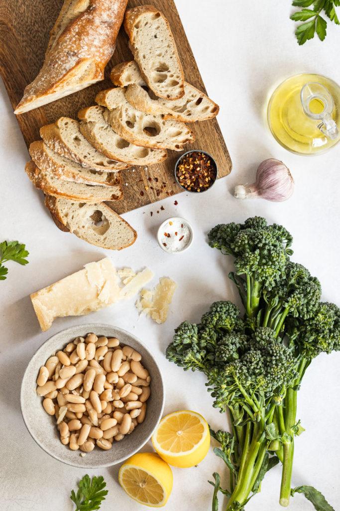Baguette slices, cannellini beans, broccolini, parmesan, and lemons.