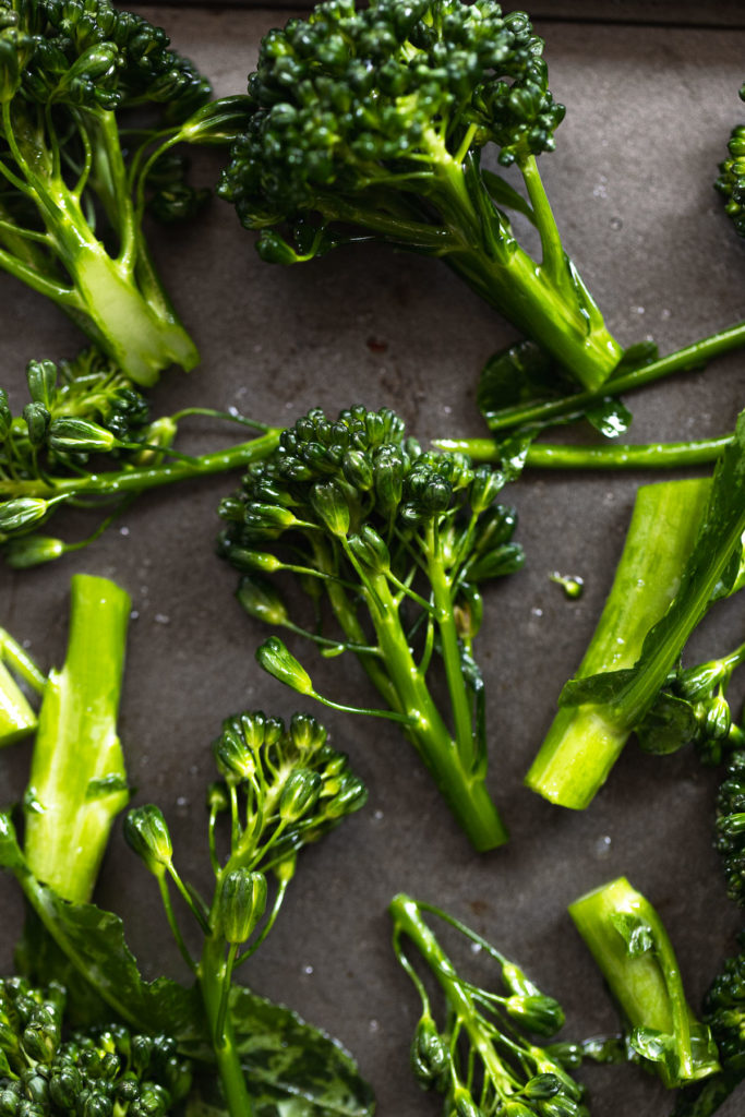 Broccolini pieces on baking sheet.