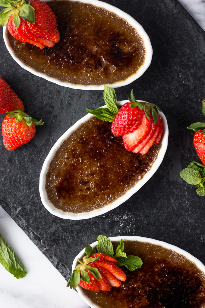 Nutella Creme Brûlée - A dessert dressed to impress! A subtle tone of Nutella in a creamy custard base with a brûléed sugar top layer. Garnish with strawberries for a delectable dessert! | Fork in the Kitchen