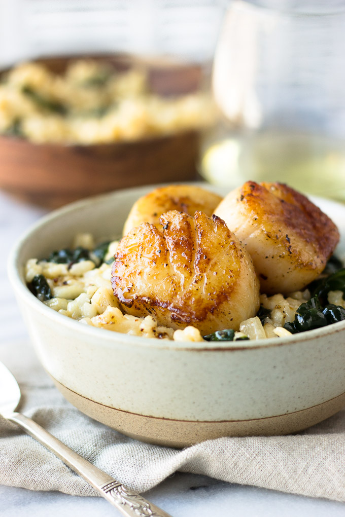 Parmesan Kale Risotto with Scallops for Two - A comforting, cheesy, creamy risotto packed with nutritious kale and melt-in-your-mouth scallops! Perfect for date night! | Fork in the Kitchen