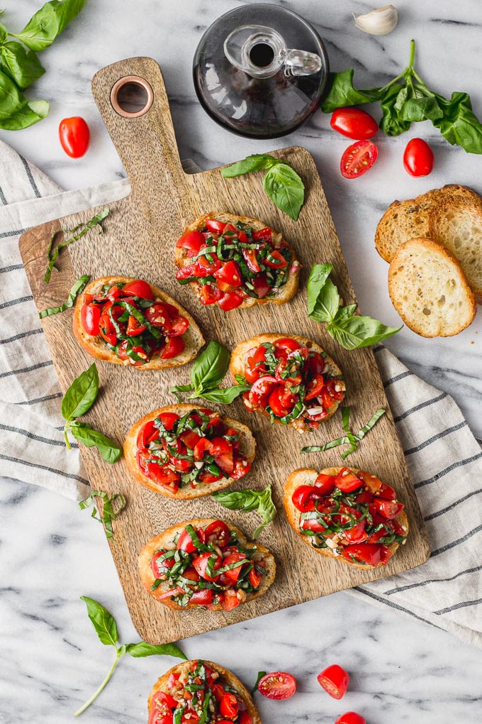 Overhead view of multiple crostini on serving board.