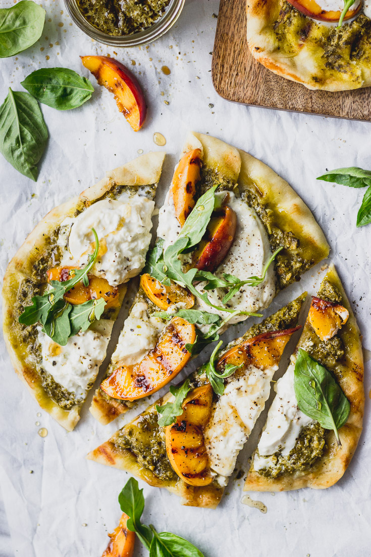 Overhead sliced flatbread with grilled peaches.