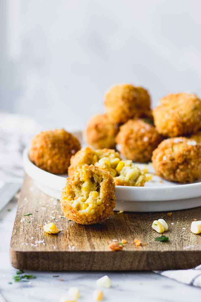 scalloped corn arancini bite on plate and serving