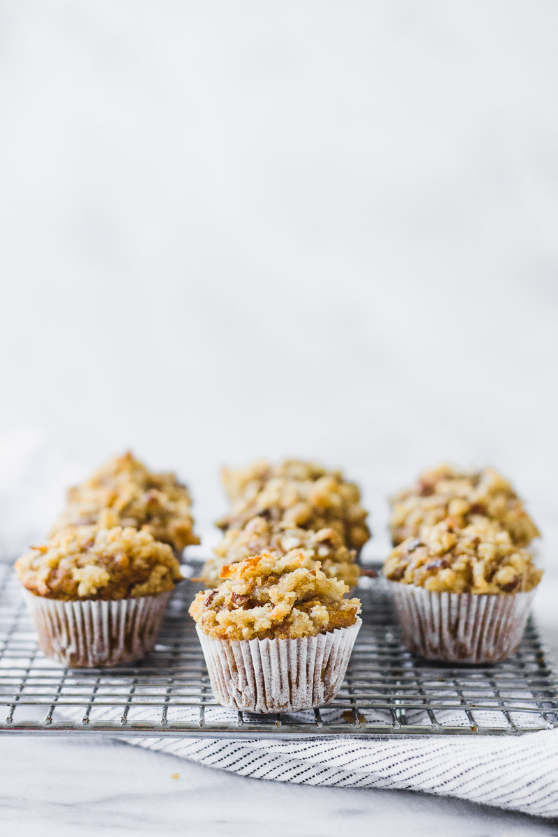 mini pumpkin coconut muffins on cooling rack with linen by fork in the kitchen
