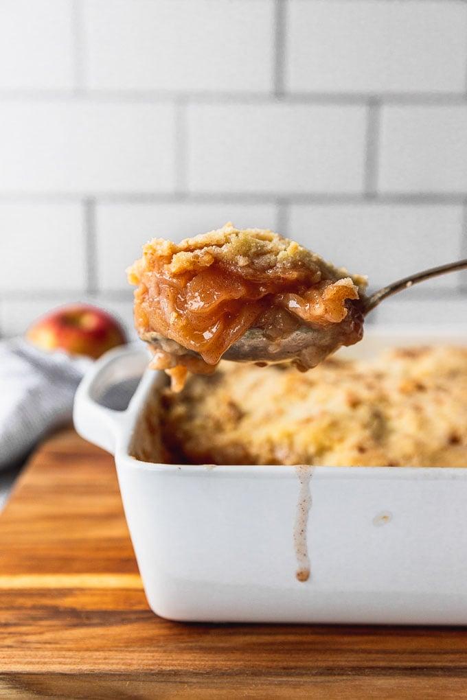 scoop of apple crisp from the pan