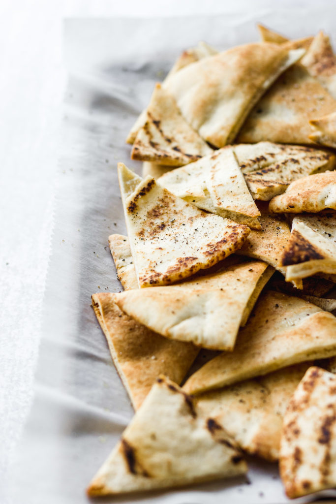 pita bread on baking sheet by fork in the kitchen