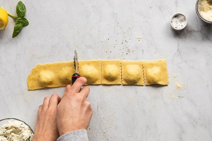 Cutting out ravioli pockets.