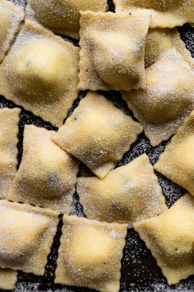Up close ravioli on baking sheet.