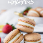 strawberry macarons in silver pot on marble board
