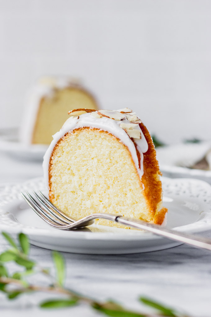 slice of lemon almond cake on plate with fork