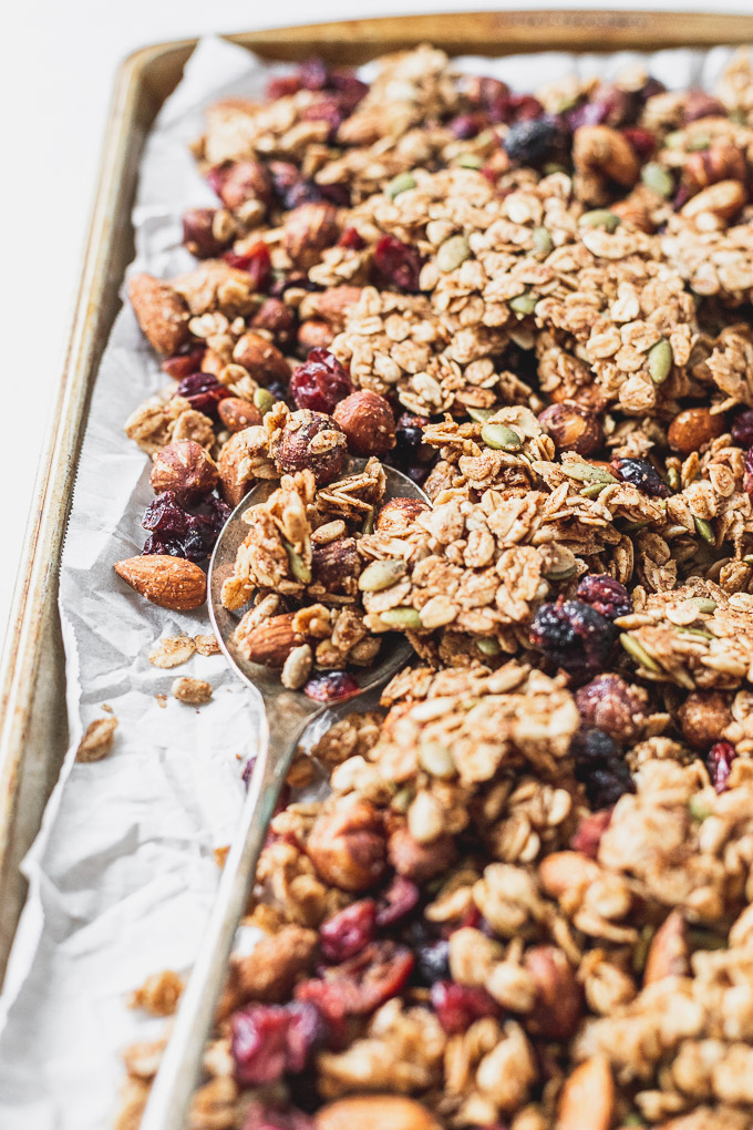 Tray of homemade cinnamon granola with spoon