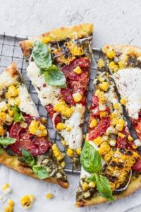 naan pizza recipe with burrata corn tomatoes and pesto