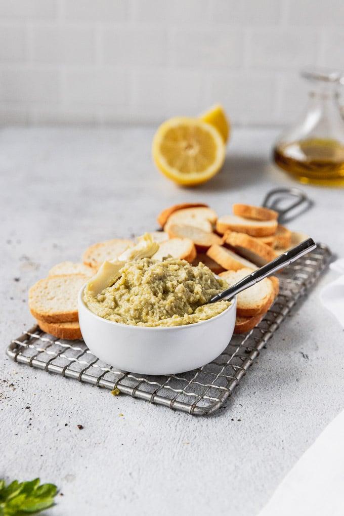 artichoke tapenade in bowl with spoon