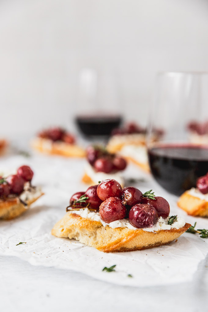 up close roasted grape crostini with wine