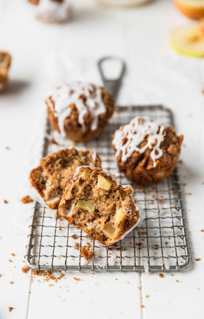 torn apart apple cider muffin on tray