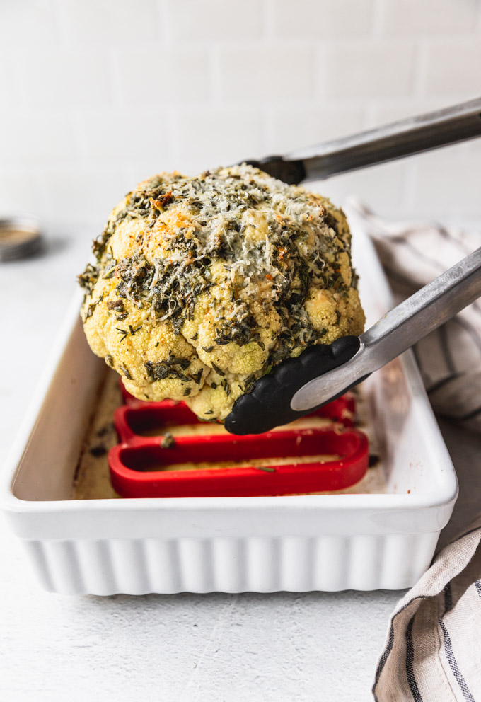 transferring cooked cauliflower from baking pan