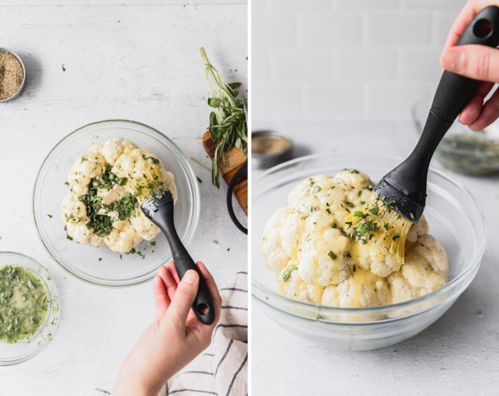 brushing on garlic butter with herbs onto cauliflower