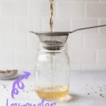straining lavender out of simple syrup into mason jar