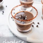 glasses of chocolate white russian with chocolate swirls as garnish on white tray