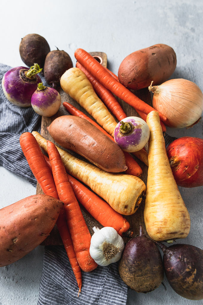 root vegetables in pile next to linen