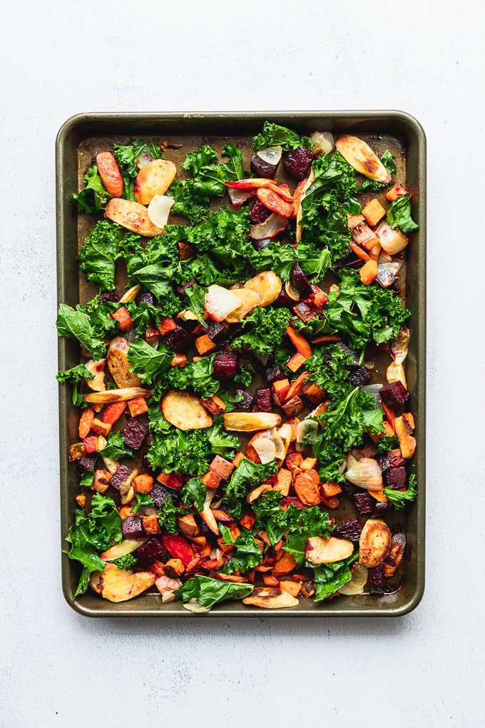 root vegetables on baking sheet roasted with kale