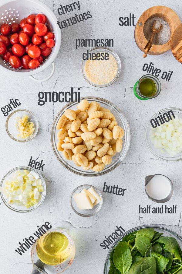 one pan creamy gnocchi ingredients laid out in bowls on white background