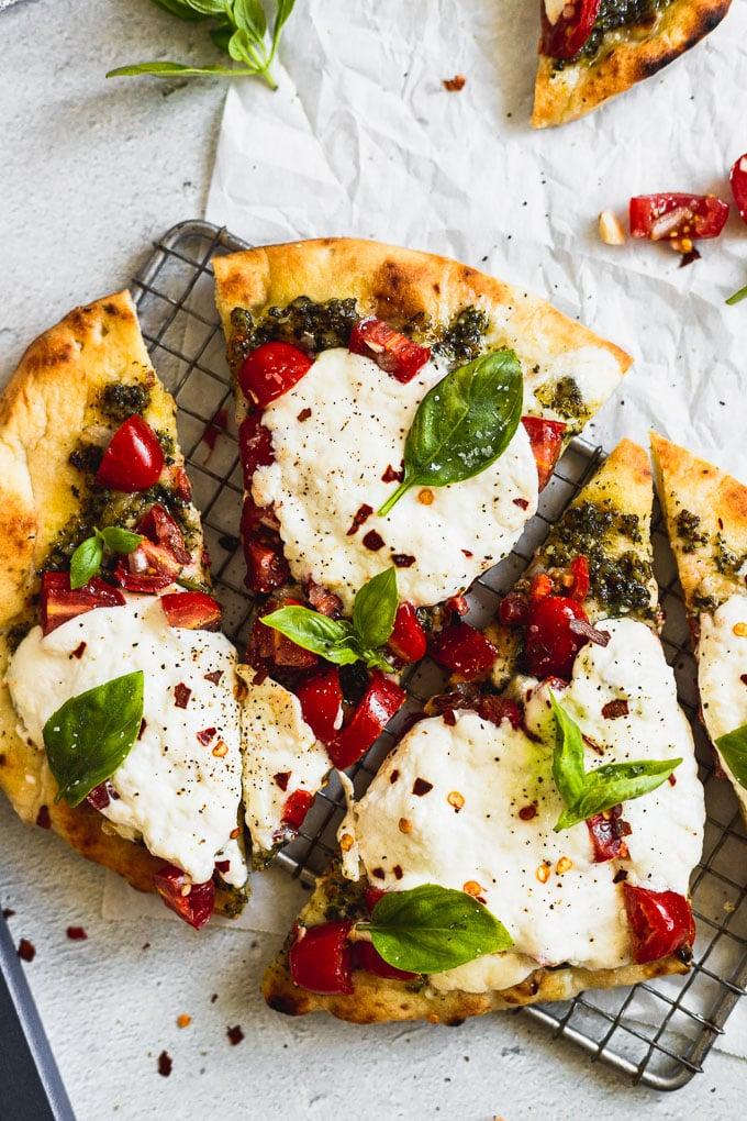 up close slice of bruschetta flatbread pizza