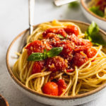 side view of cherry tomato sauce on pasta