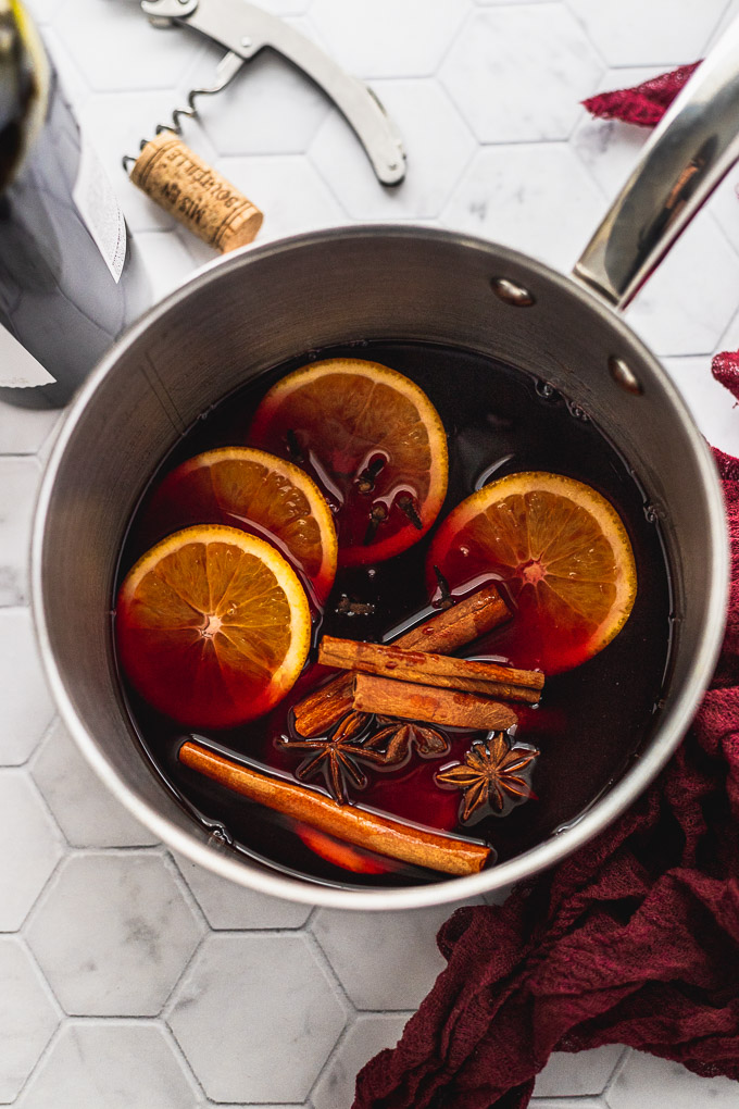 Red wine added to saucepan.
