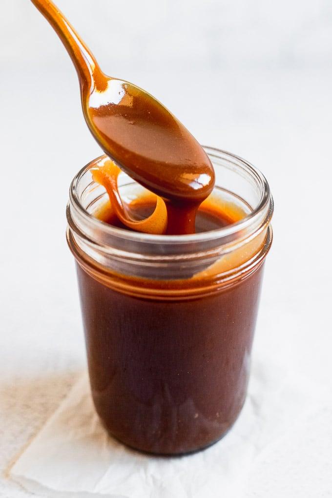 spoon lifting up bourbon caramel
