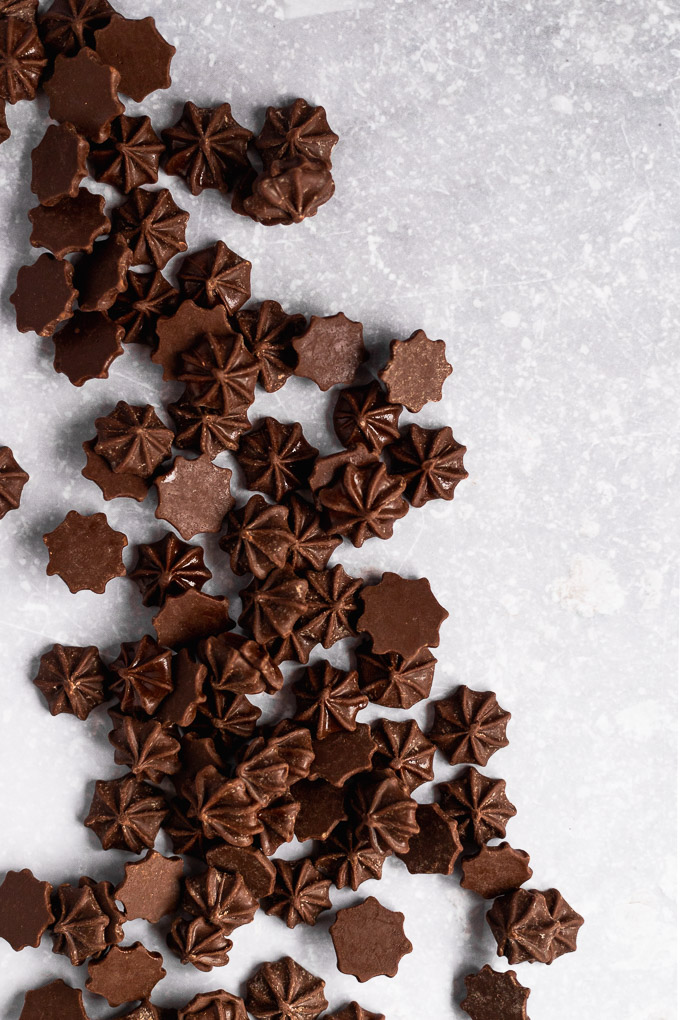 chocolate stars spread out on gray background