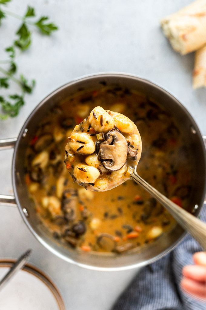 ladle of mushroom gnocchi soup