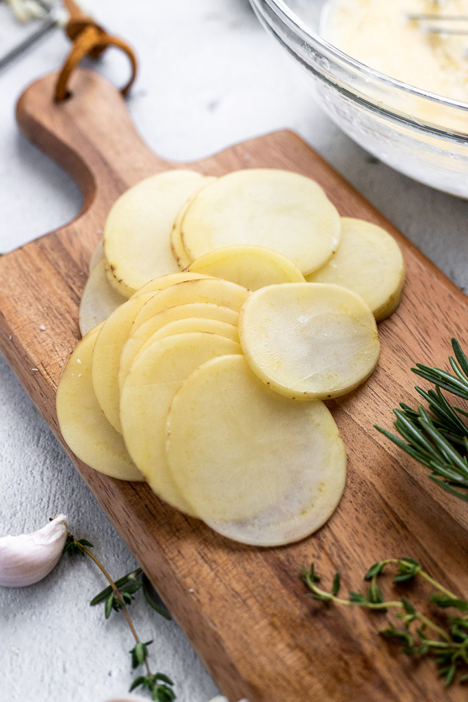 sliced potatoes on cutting board