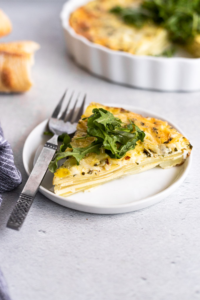 slice of potato egg casserole on white plate