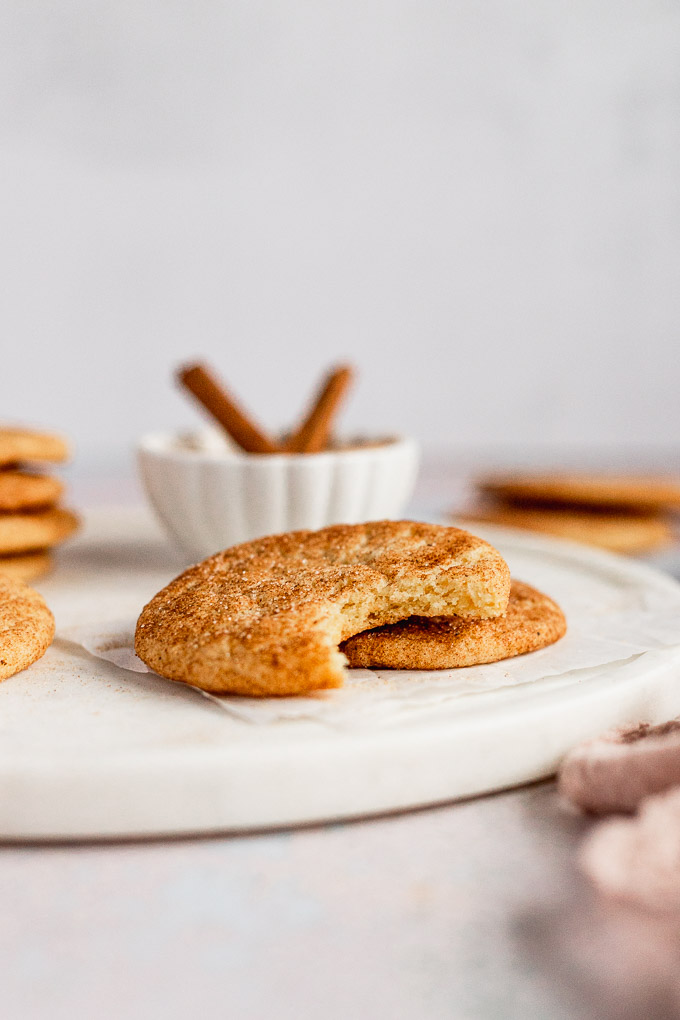 snickerdoodle cookie with bite out of it on white tray