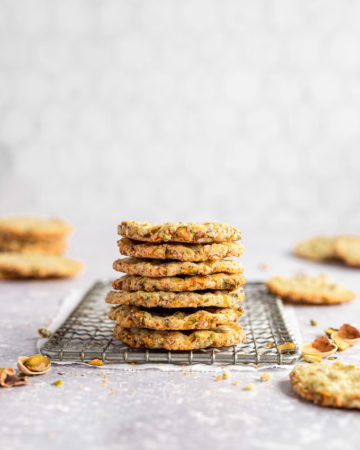 stacked pistachio butter cookies on wire rack