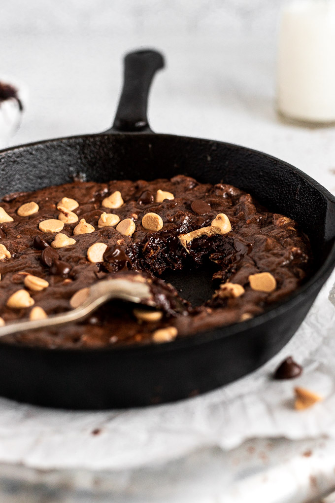 inside of brownie skillet in cast iron with bite taken out