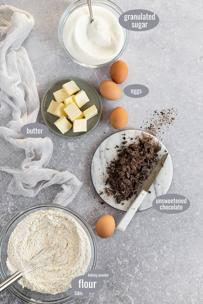 ingredients on plate: flour, chocolate, eggs, butter, sugar