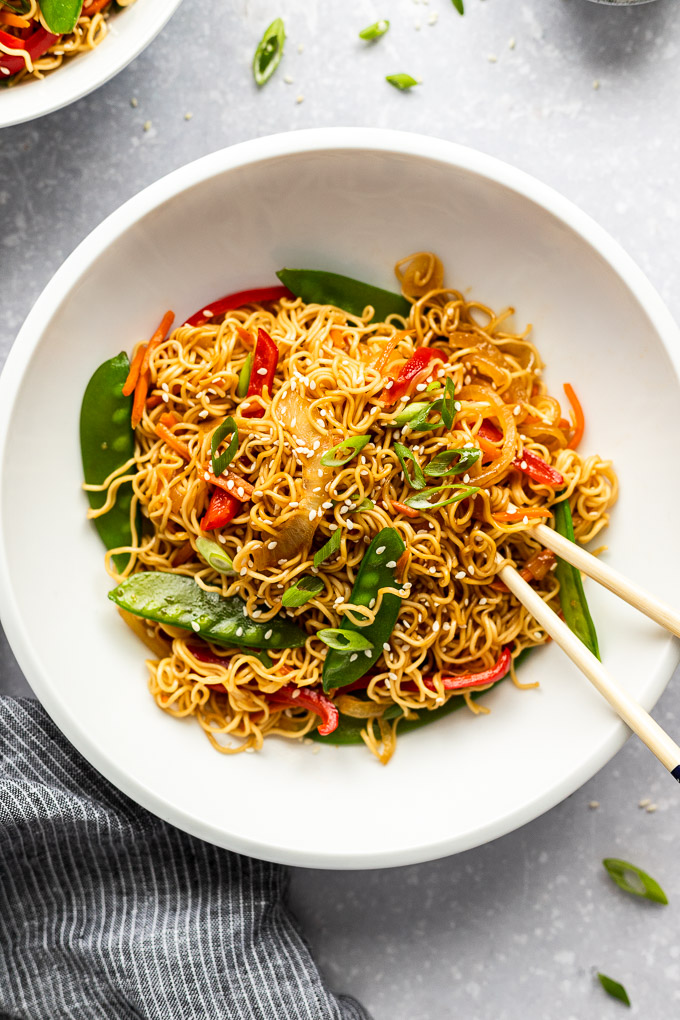 white bowl with vegetable lo mein and chopsticks